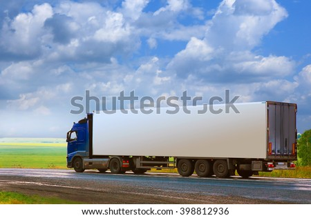 truck with the container goes on the country highway