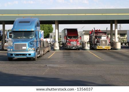 Trucks at fuel station - stock photo