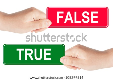 True and False traffic sign in the hand on the white background - stock photo