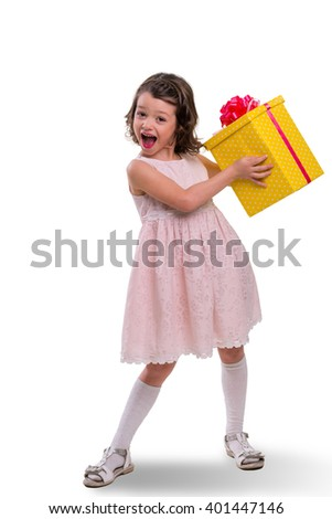 True emotion of happiness after receiving a gift in a big yellow spotted box with red ribbon. Pleased with a present. Nice idea for decoration of boxes for holidays and special events. - stock photo