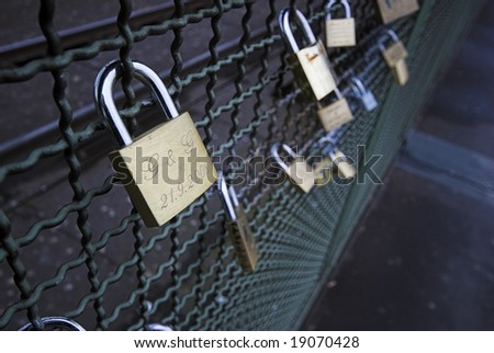 True Love. Padlocks with lovers name on chained to the Hohenzollern Bridge in Cologne, Germany.