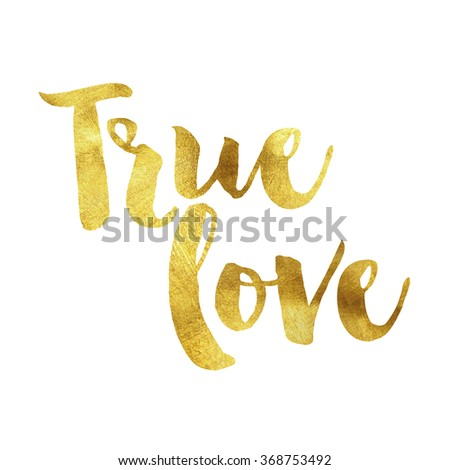 True love written in gold leaf, romantic valentines message - stock photo