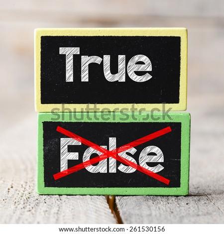 True or False Blackboards. True or False Blackboards on wood background - stock photo