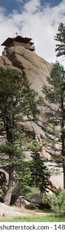 True vertical panorama of the fire lookout watchtower on top of the Devil's Head rock formation in central Colorado. - stock photo