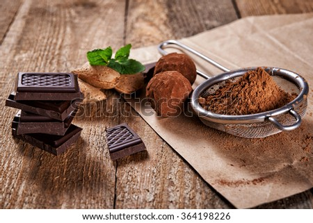 truffles, broken chocolate bar and cacao
