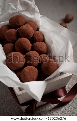 truffles of slightly bitter chocolate with hazelnut center - stock photo