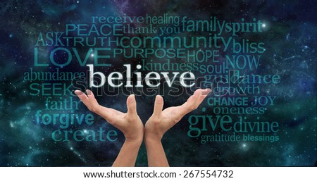 Truly Believe - Female hands reaching up into the night sky with the word 'believe' floating above, surrounded by a word cloud of wise words - stock photo