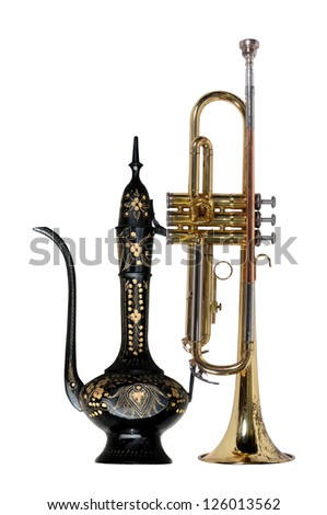 Trumpet & vintage metal pitcher - stock photo