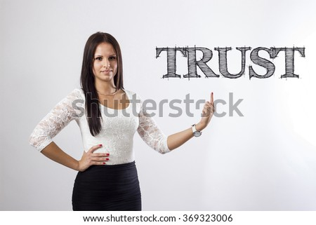 TRUST - Beautiful businesswoman pointing - horizontal image