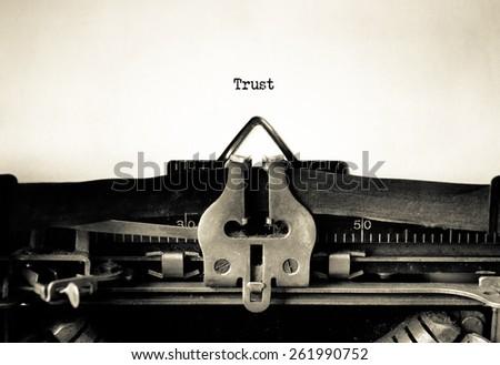 Trust sign typed on vintage typewriter - stock photo