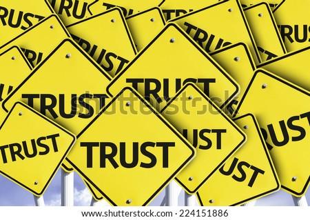 Trust written on multiple road sign - stock photo