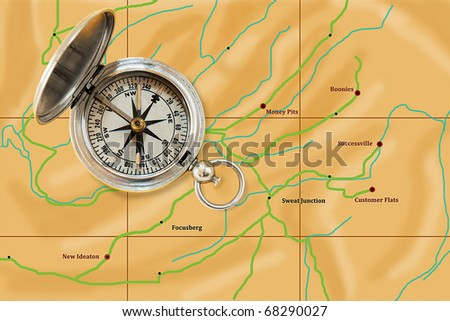 Trusty old compass guiding the way to business success - stock photo