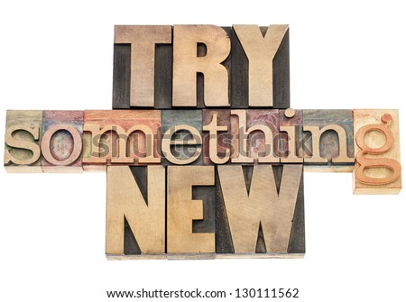 try something new -  isolated text in letterpress wood type printing blocks - stock photo