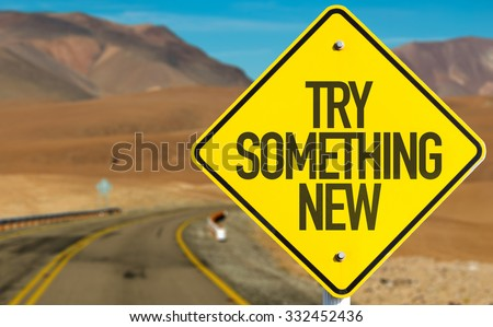 Try Something New sign on desert road - stock photo