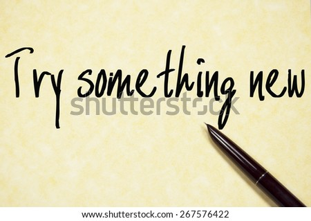 try something new text write on paper  - stock photo