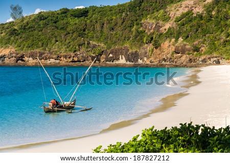 TSARABANJINA, MADAGASCAR, APR 2: A fisher boat in a creek of Tsarabanjina island near Nosy Be, Madagascar on apr 2, 2008. - stock photo