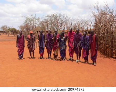 TSAVO EAST, February 15, 2006: Masai warriors performing a greeting dance for guests visiting their village near Tsavo East. Kenya, on 2006/02/15 - stock photo