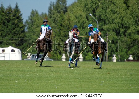 TSELEEVO, MOSCOW REGION, RUSSIA - JULY 26, 2014: Match British Schools vs Moscow Polo Club during the British Polo Day. Moscow Polo Club won 7-6 - stock photo