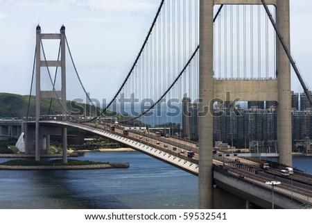 Tsing Ma Bridge in Hong Kong at day - stock photo