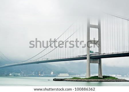 Tsing ma bridge in mist - stock photo