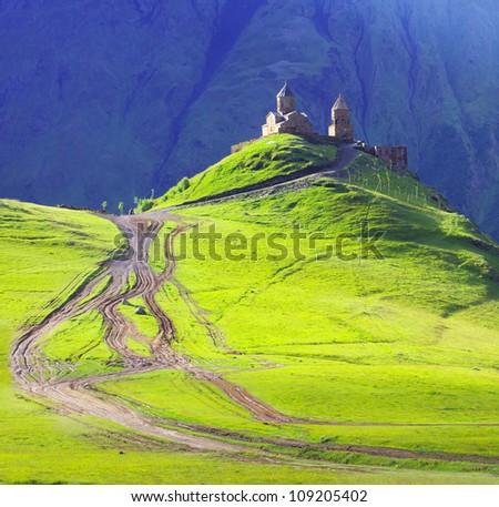 Tsminda Sameba monastery, Kazbegi, Georgian Military Highway, Georgia - stock photo