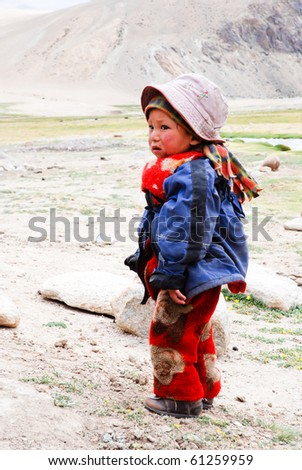TSO MORIRI, LADAKH, INDIA - JULY 21: Unidentified nomad child near Tso Moriri, July 21, 2009. In India, the mortality rate,  under-5, is 67/1000. (In USA is 8/1000) (Source World Bank)