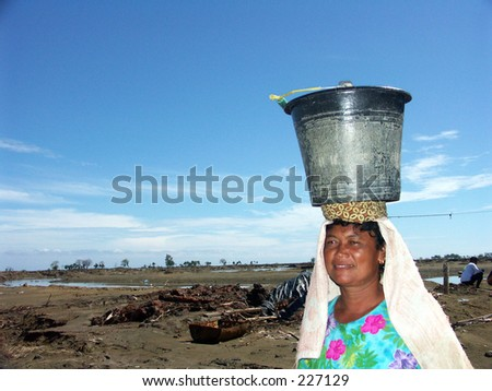 Tsunami refugee is struggling for clean water in Aceh Indonesia.