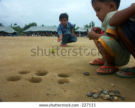 Tsunami's children are playing traditional toy at Aceh Indonesia.