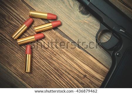 TT handgun. Soviet gun on vintage wooden boards background. retro pistol. instagram image filter retro style - stock photo
