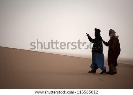 Tuaregs in the Sahara Desert - stock photo