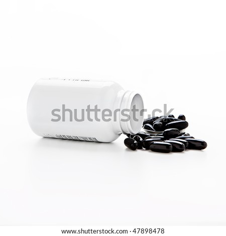 Tub of tablets health and fitness - stock photo