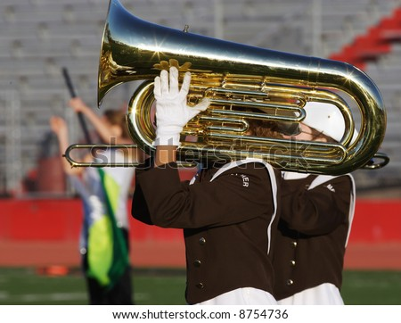 Tuba player in a marching band - stock photo