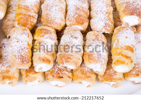 tube of pastry filled with snow, very sweet cookies, traditional czech sweet