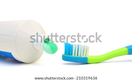 Tube of toothpaste and toothbrush. Isolated on a white.  - stock photo