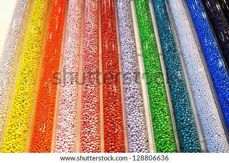 Tubes of colorful candy useful as a background pattern - stock photo