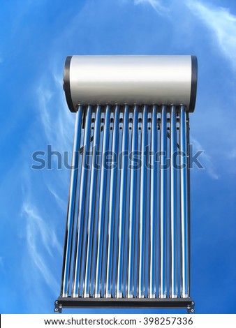 tubes of solar water heater over blue sky background - stock photo