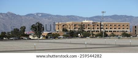 TUCSON, AZ - NOVEMBER 25, 2014: The University of Arizona Medical Center against Santa Catalina mountain range and blue sky as seen from south side. - stock photo