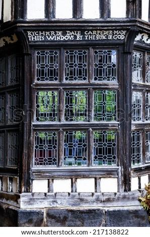 Tudor bay window built by Rycharde (Richard) Dale in the sixteenth century. - stock photo