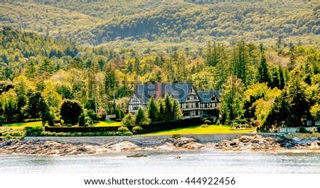 Tudor Mansion on Green Coast of Maine near Bar Harbor - stock photo