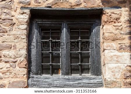 Tudor window set in stone cottage - stock photo