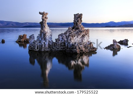 Tufa tower rock formations in Mono Lake are calcium-carbonate spires and knobs formed by interaction of freshwater springs and alkaline lake water. - stock photo