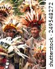 Tufi, Papua New Guinea, 4 December 2008 : Papuan Korafe tribe warriors wearing traditional bird of paradise feather headdress and body decorations during local festival - stock photo