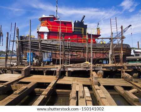 Tug boat at dry dock being renovated