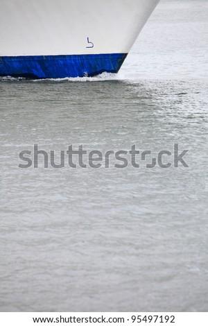 Tug boat bow creating spray outdoor sea - Cruise ship details - stock photo