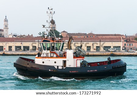 Tug boat in front of the old port terminal in Venice, Italy