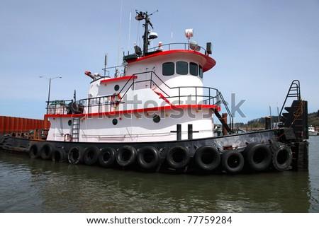 Tug boat moored in Astoria OR. - stock photo