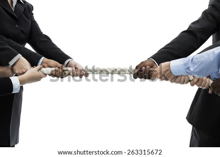 Tug of war between businessmen and businesswomen on white background - stock photo