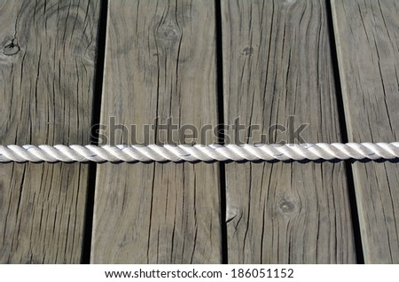 Tug of war on wooden planks background. business concept photo of  competition, challenge, achievement, determination, endurance, success. - stock photo