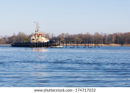 Tug on the river - stock photo