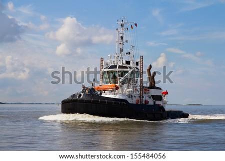 Tugboat in Bremen Harbor - stock photo